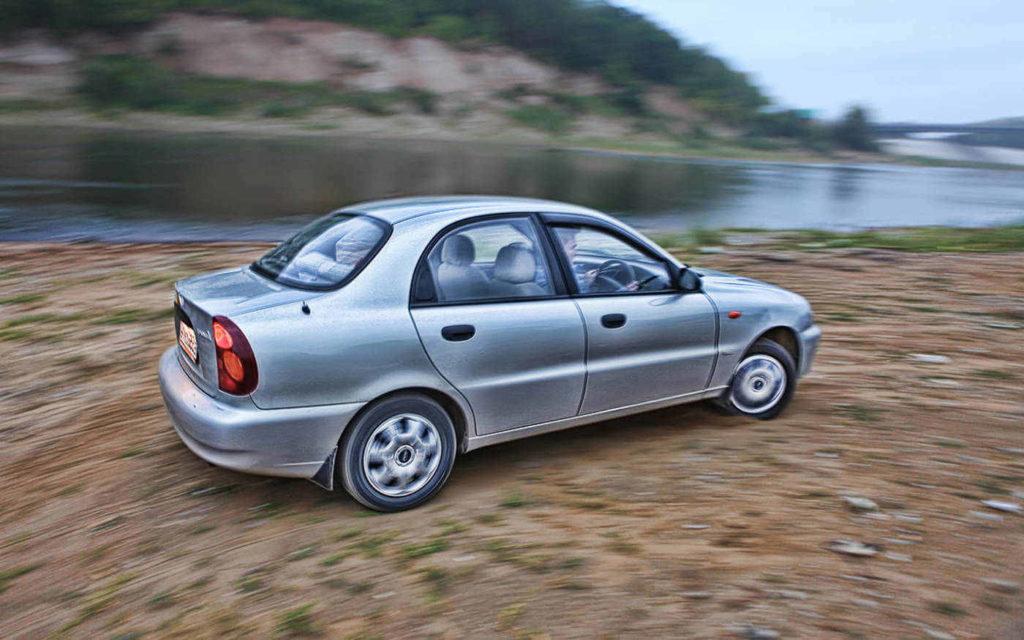 Grey four-door Chevrolet sedan