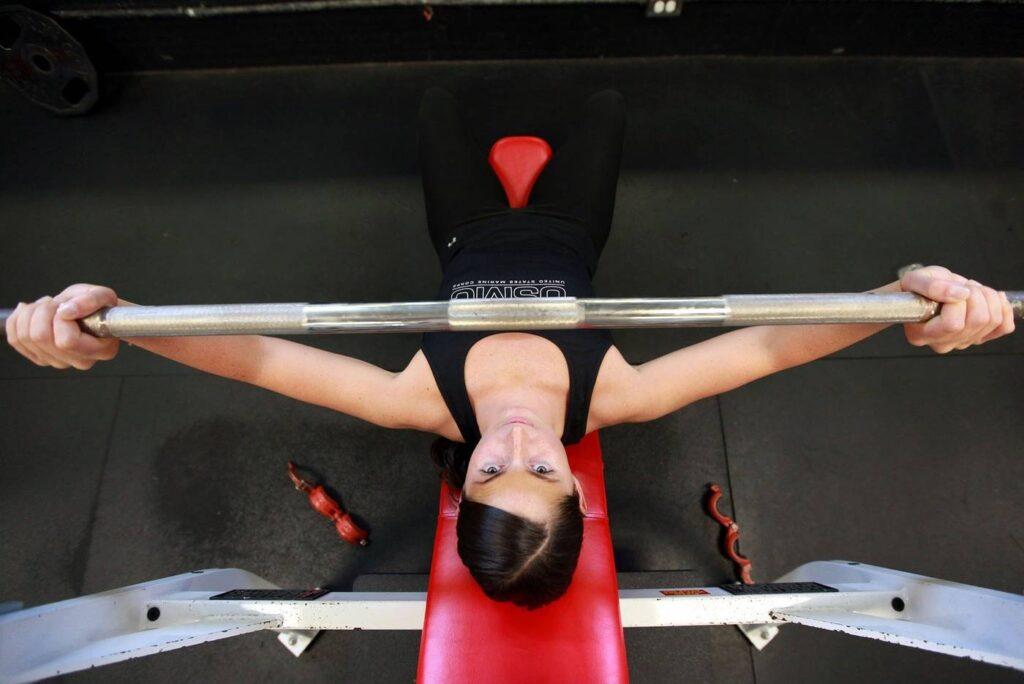 Woman doing bench press