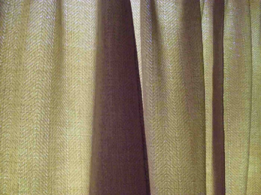 Thick greenish-brown curtains