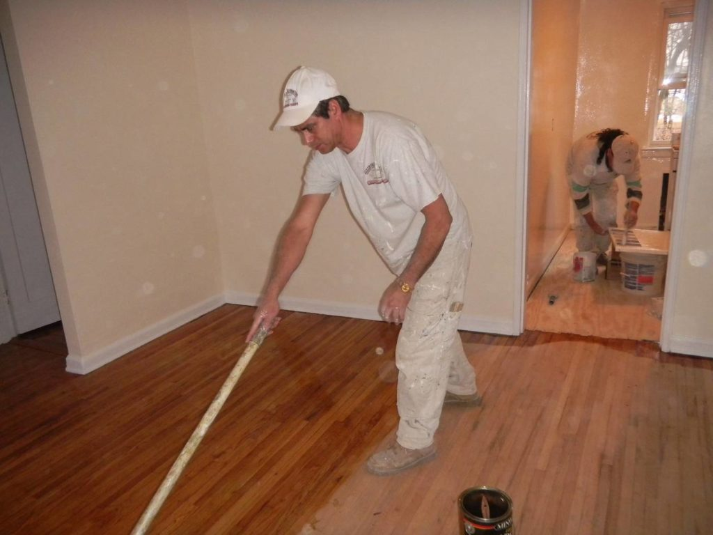 Floor being stained with polyurethane