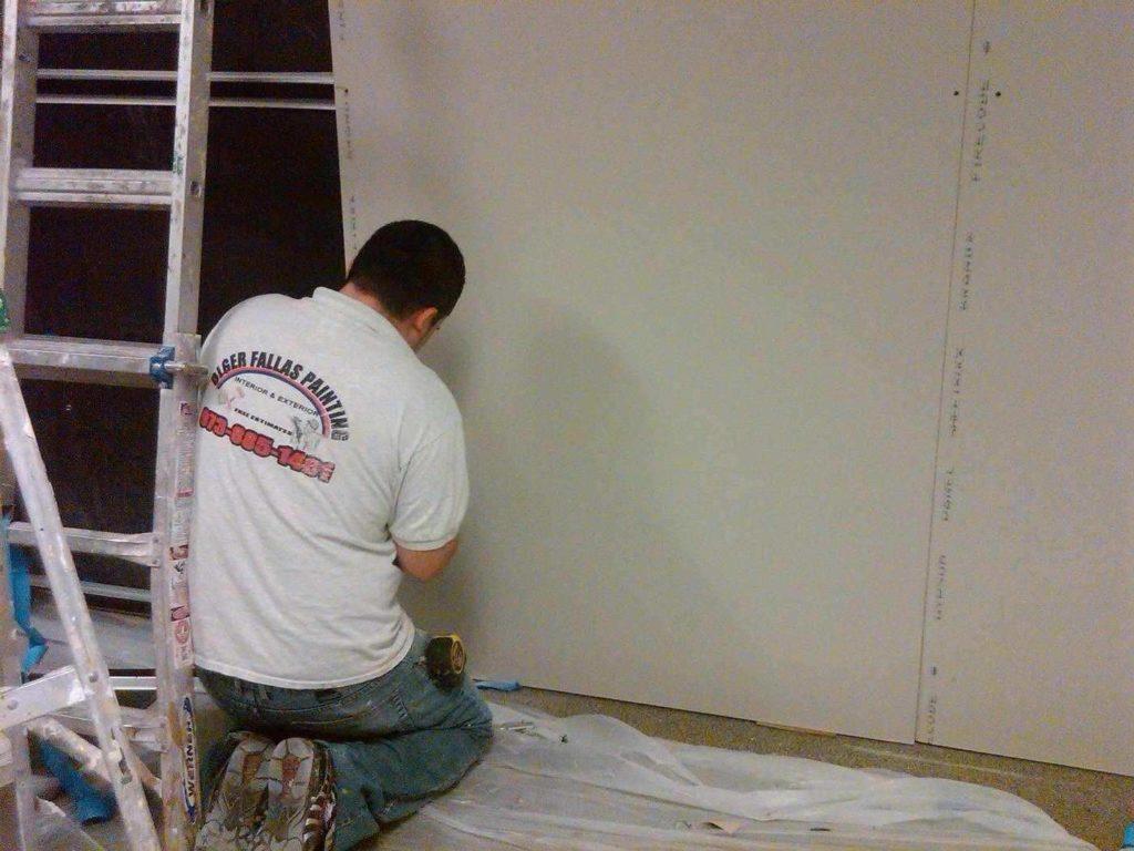 Man installing drywall